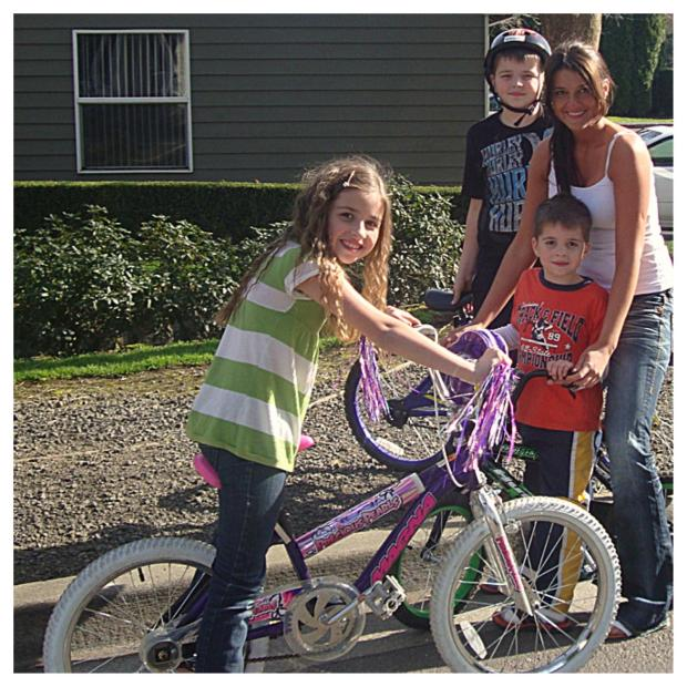 The family pictured together on the day Melanie taught her youngest, Timothy (5), to ride his bike without training wheels.